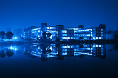 Building and reflection at night. /blue Royalty Free Stock Photos