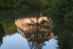 Building reflection on a water surface Stock Image