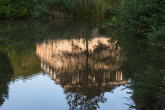 Building reflection on a water surface Royalty Free Stock Photography