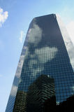 Building Reflections. Clouds and Sky reflecting on city building royalty free stock image