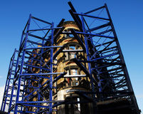 Building Renovation. Old Victorian brick building with blue scaffolding during renovation Stock Image