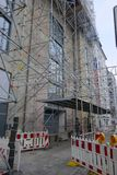 Building renovation with the help of a scaffolding royalty free stock photo