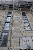 Building renovation with the help of a scaffolding stock photography
