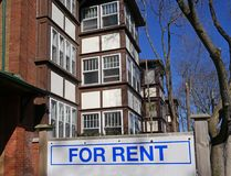 Building with for rent sign. Older low rise apartment building with for rent sign stock photography