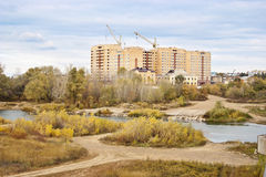 Building on the river bank. Autumn Royalty Free Stock Photography