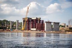 Building a road bridge across river. Construction of a new road bridge across the Yenisei River in Krasnoyarsk, Russia Stock Images