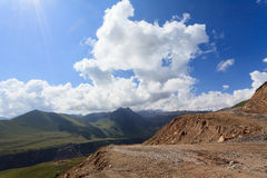 Building roads in the mountains. Caucasus, Russia Royalty Free Stock Image