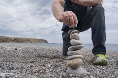 Building a Rock Stack at Rapid Bay, South Australia Stock Image