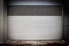 Building with roller shutter door Stock Photo