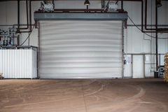 Building with roller shutter door Royalty Free Stock Images