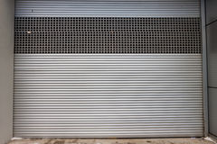 Building with roller shutter door Stock Photos
