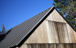 Building roof. Roof on a building with beautiful trees and blue sky stock photos