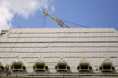 Building roof. Construction with crane Stock Photography