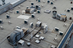 A building roof with multiple air conditioning units Stock Photos