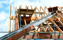 Building a roof truss. Roofing roofer with a lift Royalty Free Stock Images