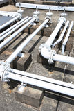 Building rooftop pipelines. Assorted pipelines on the concrete roof of a building Stock Photography