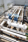 Building rooftop pipelines. Assorted pipelines on the concrete roof of a building Stock Image