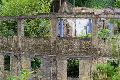 Building ruins in a forest. Ribeiro Frio on Portuguese island of Madeira royalty free stock photos