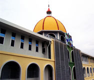 Building's dome. Upper floors of a modern building with dome on the rooftop Stock Images