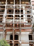 Building facade with scaffold under construction or repair restoration stock photography