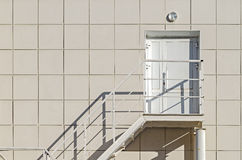 Building's Facade. The Walls Of The Cladding Aluminum Composite Panel With A Ladder And a Plastic Door. Stock Image