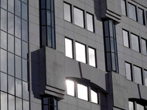 Building's Fassade. Photo of a modern office building. Windows and concrete walls Royalty Free Stock Photo