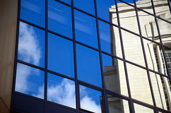 Building's reflecting in glass.