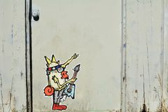 Cartoon Grafitii and Urban Art in Portland, Oregon. This is a building`s white-painted door with a cartoon graffiti image in Portland, Oregon stock photography