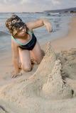 Building a sand castel. Child building a sand castle at beach Stock Photography