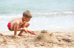 Building sand castle Stock Photos