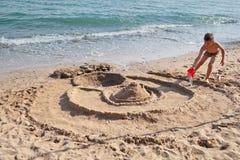 Building sand castle Stock Photos