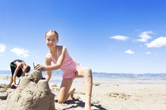 Building a Sand Castle at the Beach Stock Image