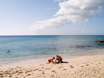 Building Sand Castles. Mother and son build sand castles on a beautiful caribbean beach, St. Croix, USVI Royalty Free Stock Photo