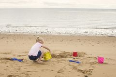 Building sand castles on the beach stock photography
