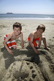 Building a sandcastle. Two cute boys building a sandcastle Royalty Free Stock Photo