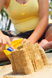 Building Sandcastle By The Beach Stock Photography