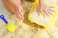 Building Sandcastle By The Beach Royalty Free Stock Photo