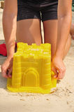 Building Sandcastle By The Beach Royalty Free Stock Image