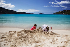Building sandcastles at Magens Bay Royalty Free Stock Image