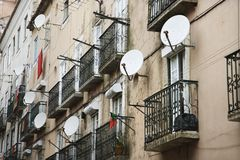 Building with satellite dishes in Portugal. Royalty Free Stock Photo