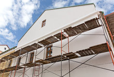 Building with scaffold under reconstruction Royalty Free Stock Images