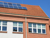 Building of the school with solar panels Royalty Free Stock Photo
