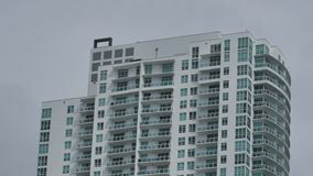 Building section closeup on a gray sky stock footage