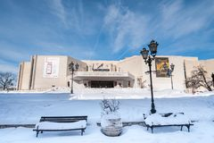 Building of Serbian National Theatre in Novi Sad founded in 1861 with snow in the cold winter day and blue sky above. Novi Sad, Serbia. January - 27. 2018 stock images