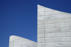 Building Shapes. A building with a unique shape against a blue sky Royalty Free Stock Images