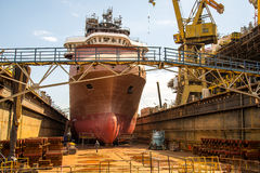 Building the ship. Building a specialized ship at the shipyard dock Royalty Free Stock Images