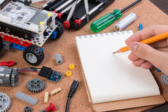 Building a simple car robot with microcontroller and notebook. Royalty Free Stock Photo