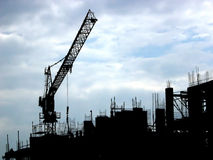 Building site 1. Silhouette of a building site on a cloudy day Stock Photos