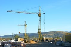 Building site. Building site with tower cranes against the sky Stock Photography