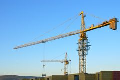 Building site. Building site with tower cranes against the sky Stock Images